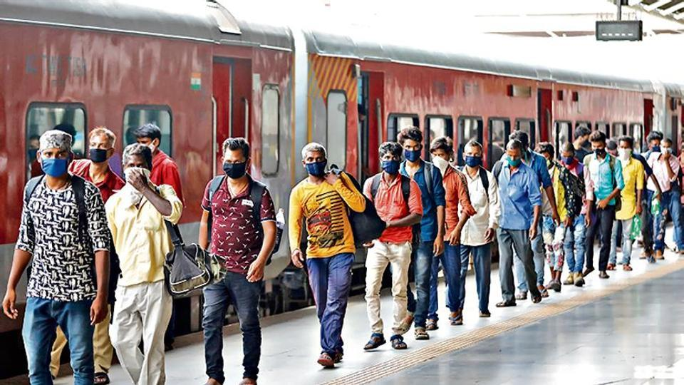 Migrant workers, who had left during the Covid-19 lockdown to their home state of Uttar Pradesh, returning to Ahmedabad.
