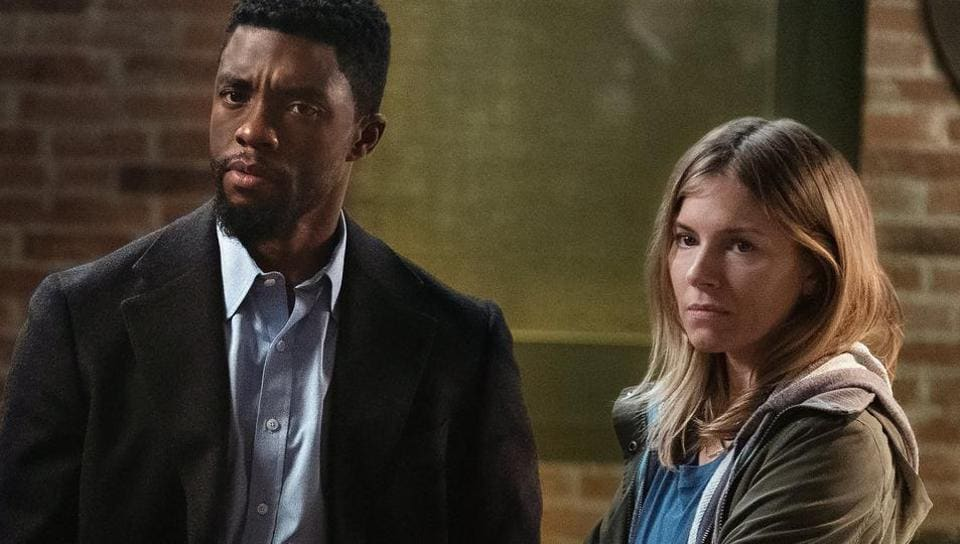 Chadwick Boseman and Sienna Miller in a still from 21 Bridges.