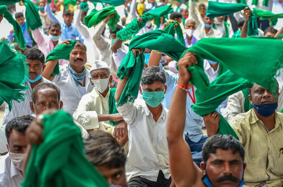 Bengaluru: Farmers protest against the passage of new farm bills in the Parliament and land legislations proposed by the Karnataka government, in Bengaluru, Tuesday, Sept. 22, 2020. (PTI Photo/Shailendra Bhojak)