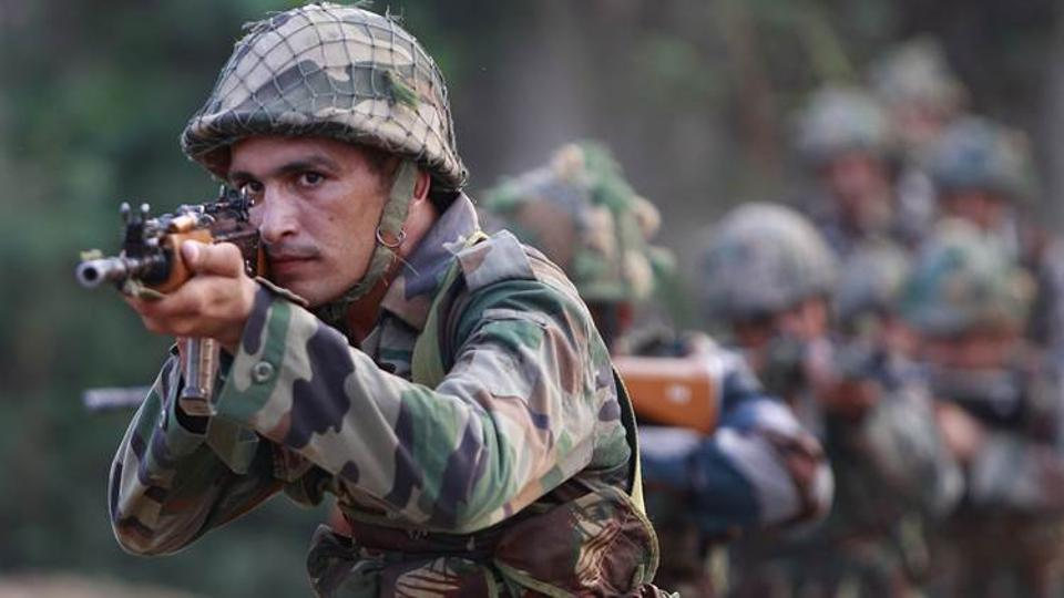 Army soldiers take positions during their patrol near the Line of Control in Nowshera sector, about 90 kilometers from Jammu.