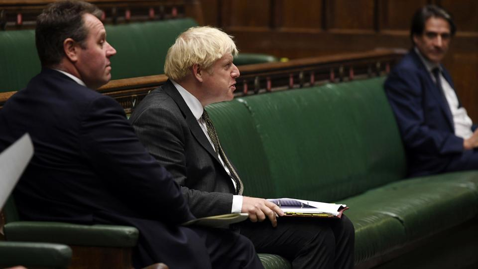 Britain's Prime Minister Boris Johnson looks on during Prime Minister's Questions in the House of Commons in London, Wednesday, Sept. 23, 2020.