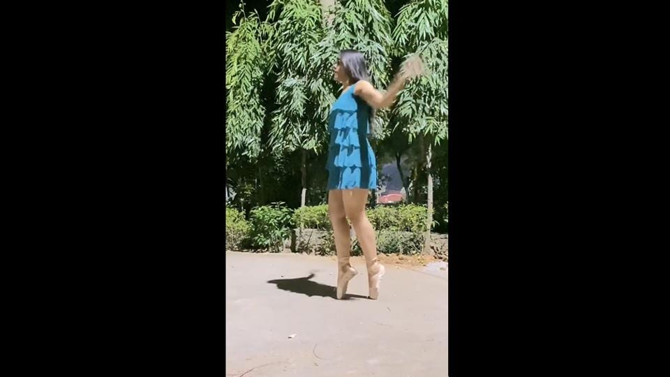 The image shows the dancer skipping on her toes.