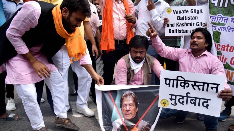 Member of Hindu Sena burn a poster of Pakistan PM Imran Khan during a protest against illegal annexure of Gilgit Baltistan into Pakistan, near teen murti in New Delhi on Wednesday.
