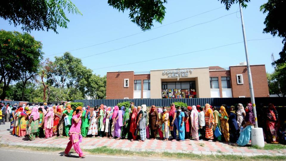 Residents queue to collect subsidised ration at the community centre in Sector 36, Chandigarh on September 29. The recovered cases have outpaced active cases by over five times, according to the health ministry. (Ravi Kumar / HT Photo)