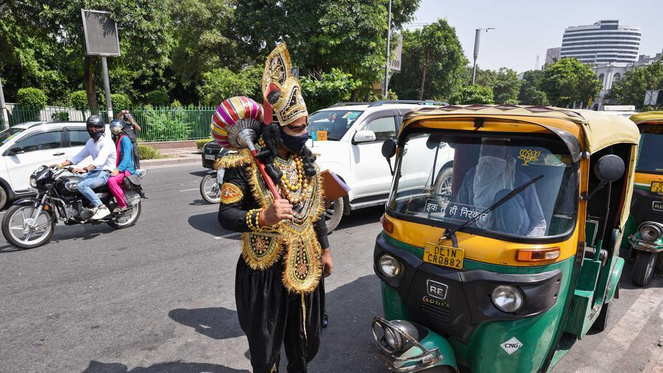 A man dressed as Hindu mythical figure 'Yamraj' during a campaign organised by the Delhi Police to raise awareness on Covid-19 safety protocols at Connaught Place in New Delhi on September 28. According to the health ministry, India has witnessed close to 100 per cent increase in recoveries in the past month. (Biplov Bhuyan / HT Photo)