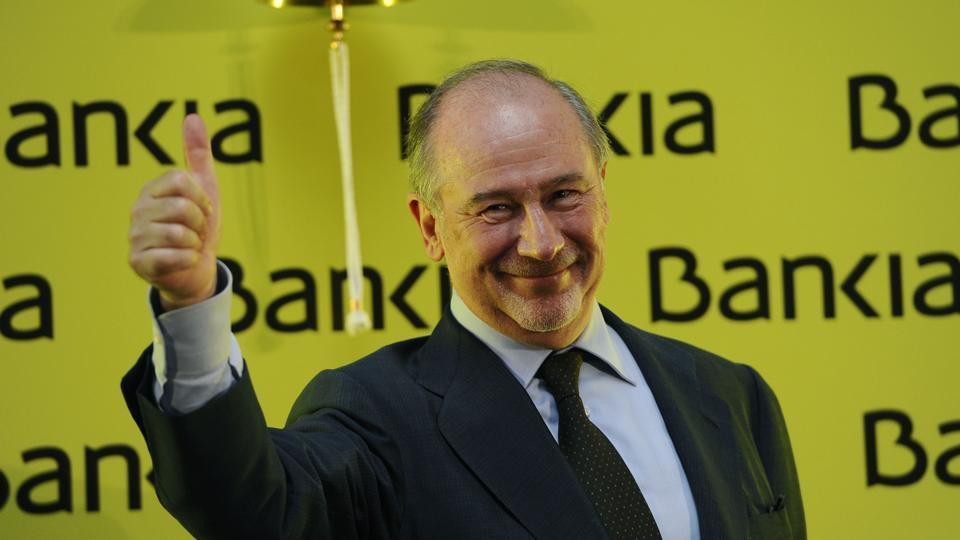 The image of a smiling Rato ringing the bell and sipping champagne on July 20, 2011 to mark the start of Bankia's listing has since become a symbol of the scandal.
