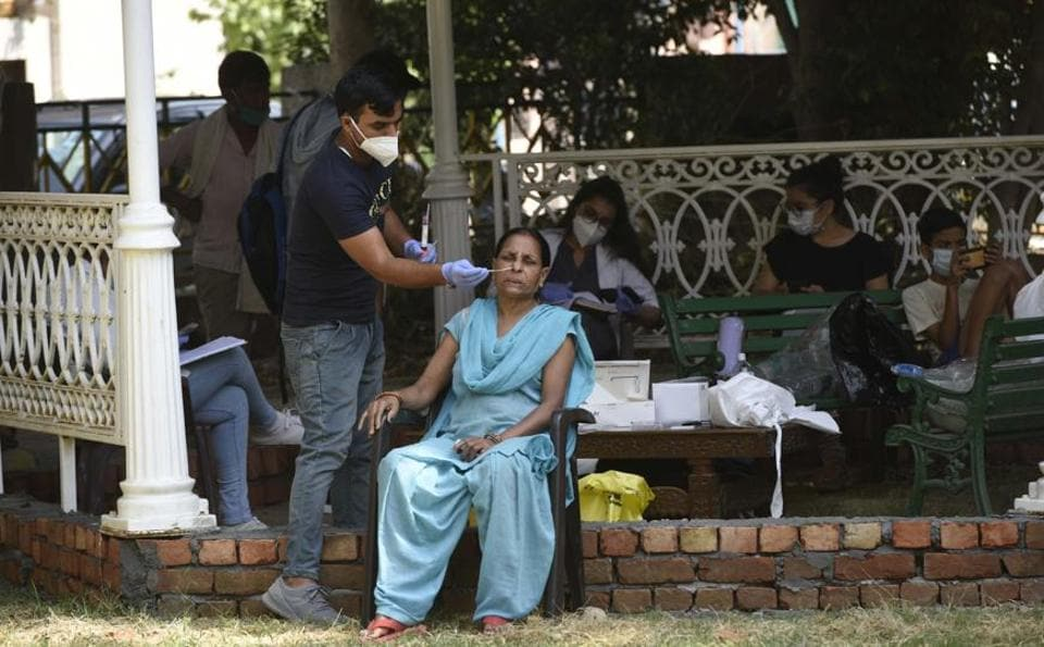 A health worker collects a swab sample from a woman for Covid testing on Monday.