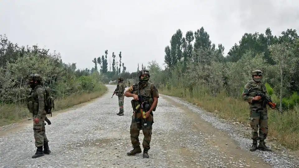 Army personnel stand guard during a gun battle with terrorists in Pulwama, Kashmir.