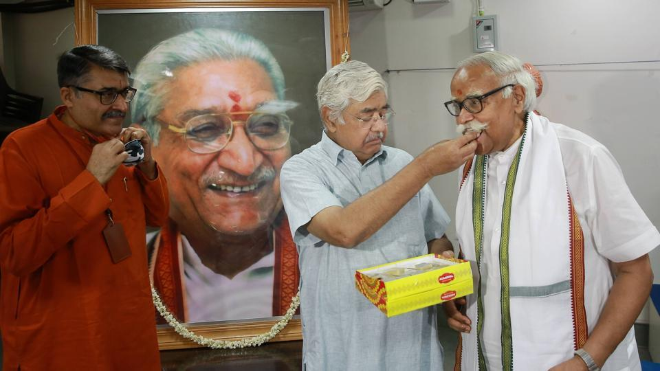 VHP Chief Alok Kumar celebrates with party leader Om Prakash Singhal during a press conference, after the verdict by the special CBI court, in New Delhi on Wednesday.
