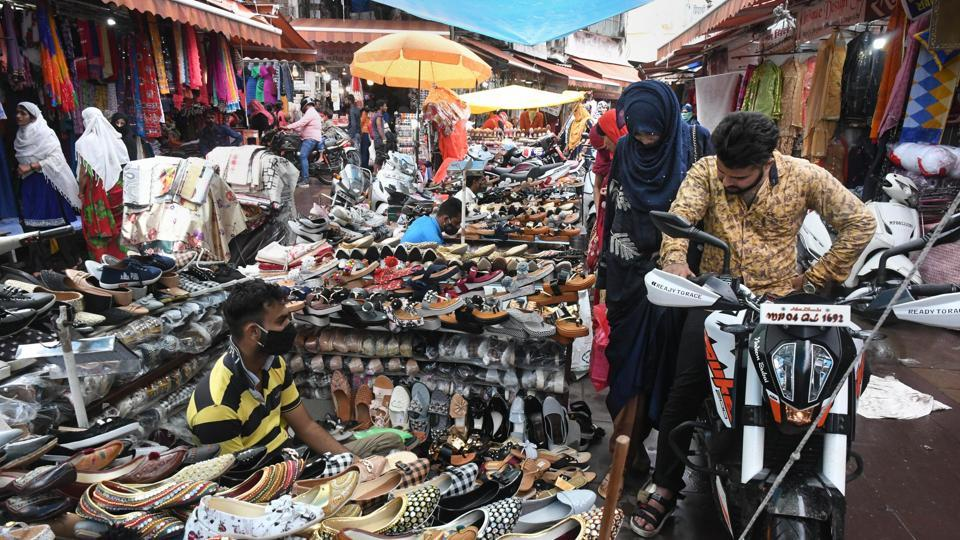 A vendor attends customers at Chowk Bazar during Unlock 4.0 in Bhopal.
