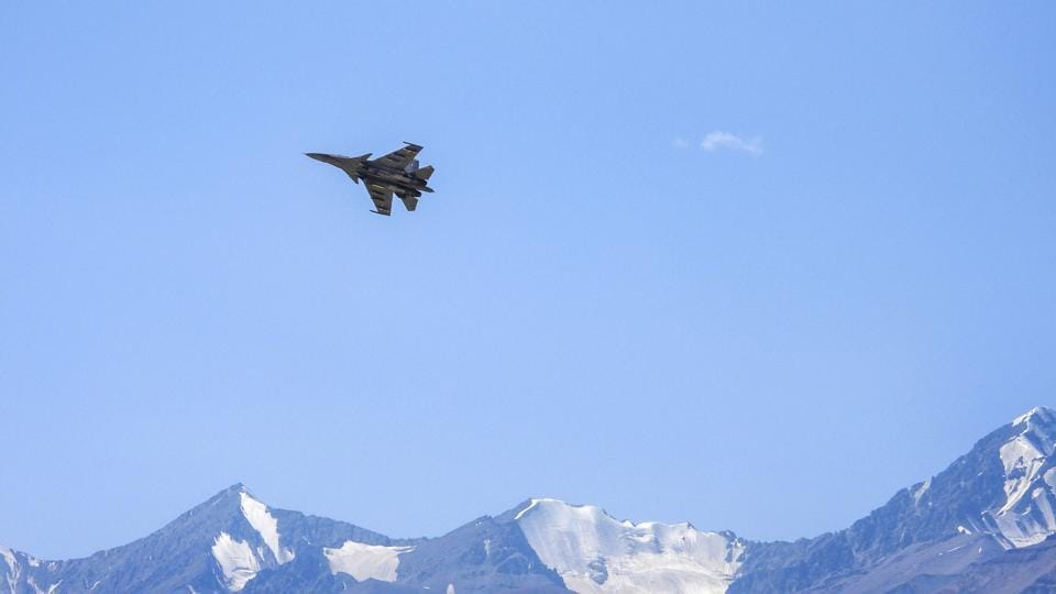 An  Indian Air Force fighter jet flies in the Ladakh region amid the prolonged India-China face off, in Leh district on Wednesday.