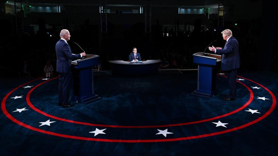 US President Donald Trump and Democratic presidential nominee Joe Biden participate in the first 2020 presidential campaign debate held on the campus of the Cleveland Clinic at Case Western Reserve University in Cleveland, Ohio.