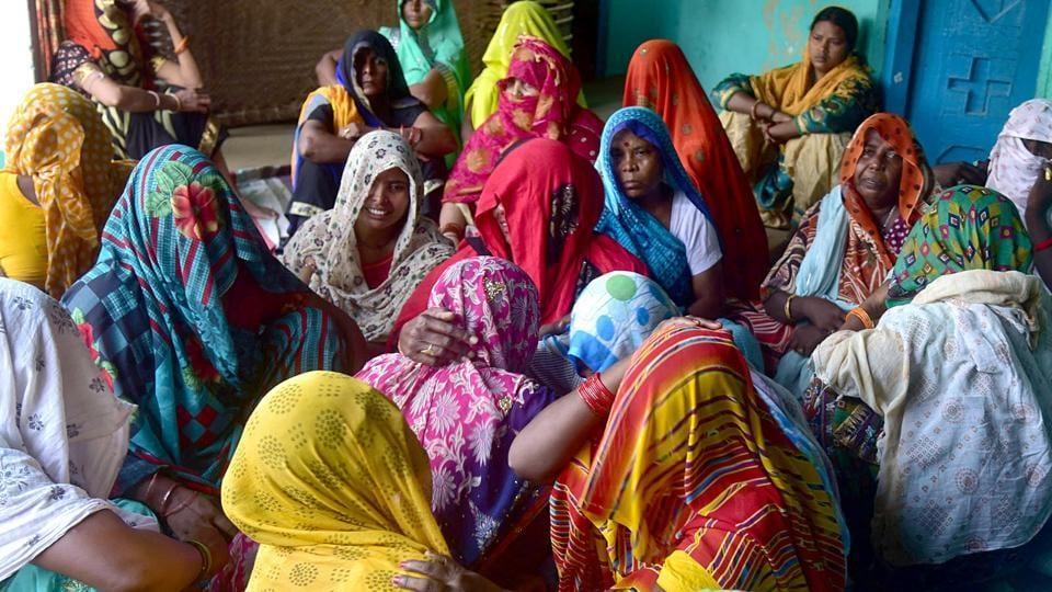 Relatives of the rape victim mourn her death, at her village in Uttar Pradesh's Hathras district.