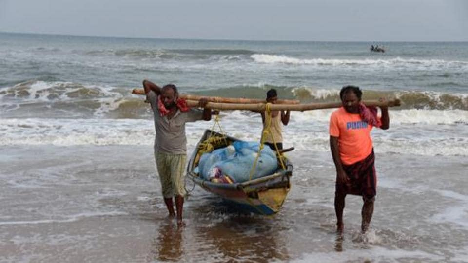 Fishermen pull their boat ashore in Puri earlier in June. Monsoon months extend from June to September.