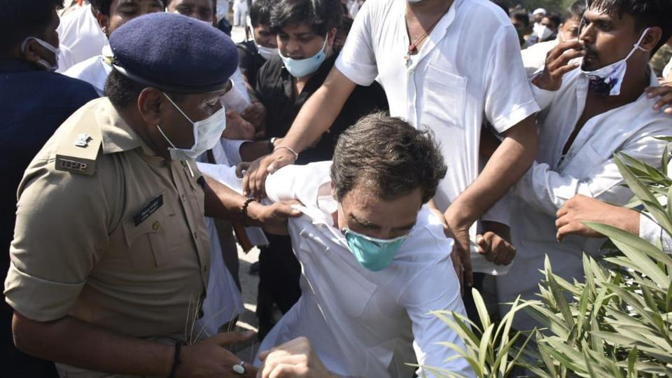Rahul Gandhi seen taking a tumble even as a policeman tries to hold the leader by his kurta. (HT Photo)