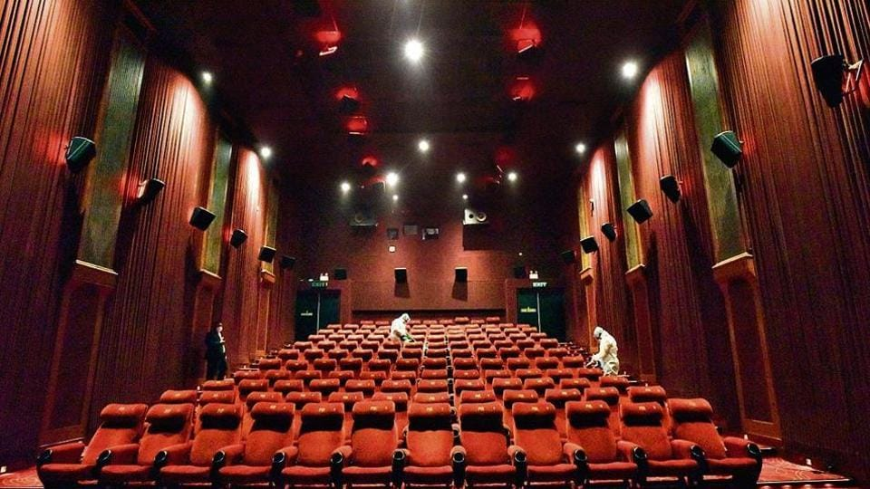 A worker chemically disinfects the premises inside a cinema hall at PVR ICON during a press preview to show their preparedness of reopening halls amid the Covid-19 pandemic, at DLF Promenade, Vasant Kunj, in New Delhi.