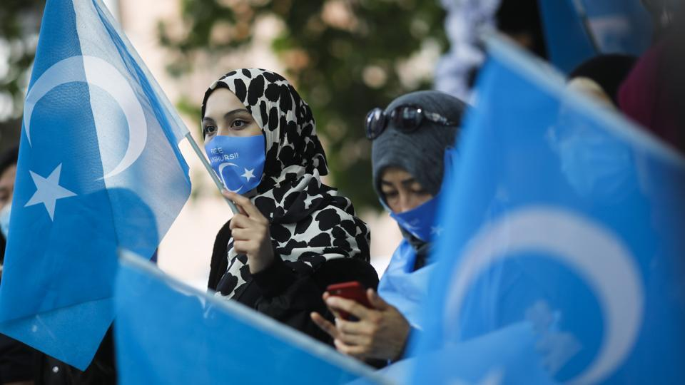 Uyghurs women take part in a protest during the visit of Chinese Foreign Minister Wang Yi in Berlin, Germany, Tuesday, Sept. 1, 2020.