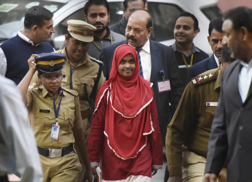 The unique power of the supreme court to shape lives:24-year-old Hadiya (Akhila) (in red) at the Supreme Court in New Delhi after a hearing on November 27, 2017.