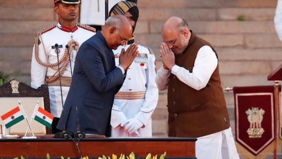 India's President Ram Nath Kovind greets Amit Shah after his oath of office during a swearing-in ceremony at the presidential palace in New Delhi.