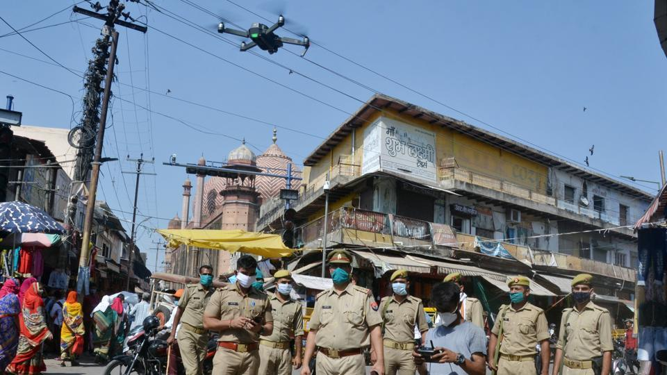 Police personnel stands guard and uses drone to check the area around Jama Masjid in Agra on Wednesday, as the all accused acquitted in the Babri Masjid demolition case by the Special CBI Court in Lucknow.