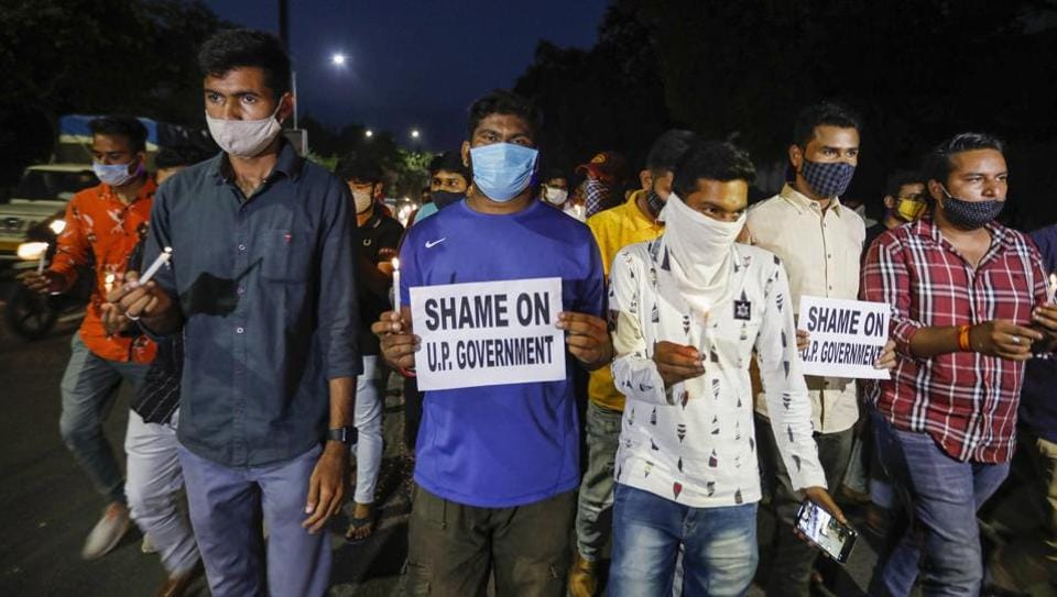 National Students' Union of India (NSUI) activists hold a candlelight march to pay homage to Hathras gang-rape victim, in front of Gujarat University in Ahmedabad.