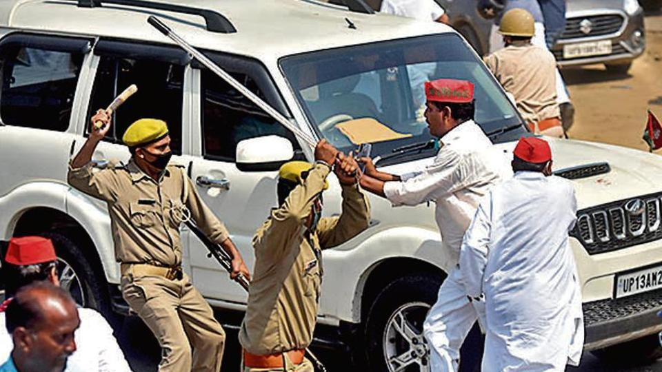 Police personnel lathicharge a protest on NH 93 by Samajwadi party workers who were trying to reach the Hathras gang rape victim's house, in Hathras, Uttar Pradesh.