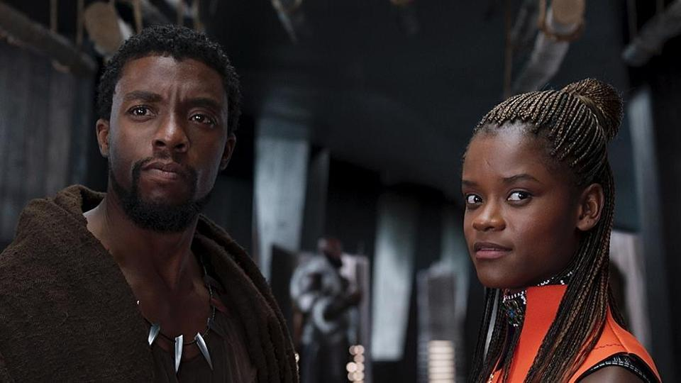 """Chadwick Boseman as T'Challa/Black Panther (right) and Letitia Wright as Shuri in """"Black Panther"""""""