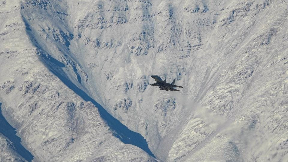 An IAF aircraft flies in the Ladakh region amid the India-China stand off, in Leh.