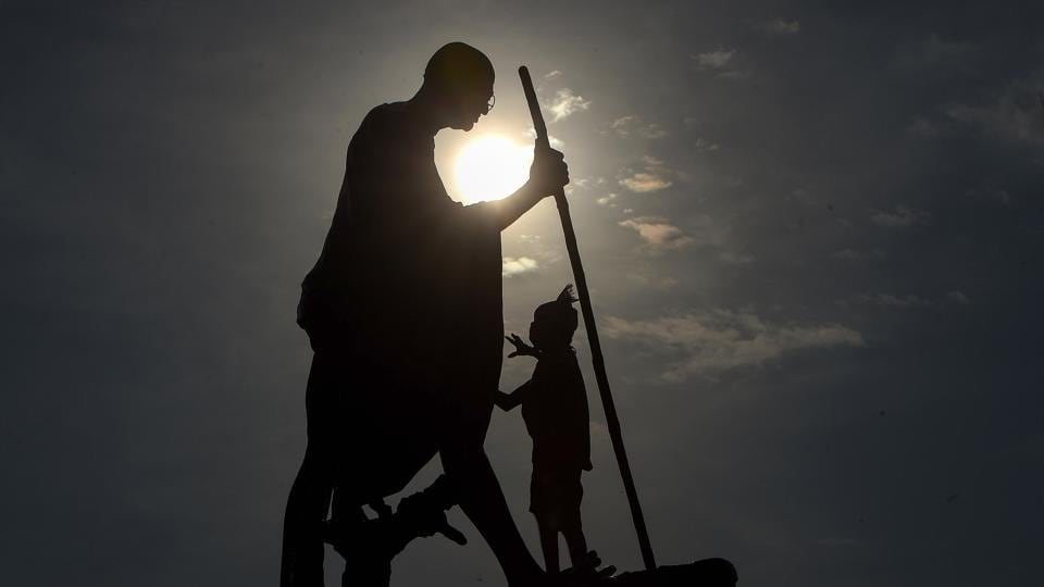 A worker cleans Mahatama Gandhi statue on the eve of his birth anniversary at Marinabeach in Chennai on Thursday.