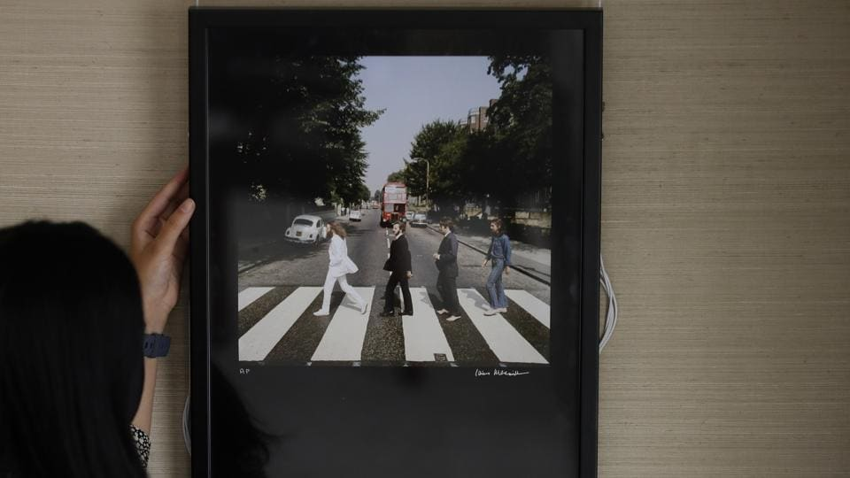 An Iain Macmillan chromogenic print of the Beatles, Abbey Road Outtakes, 1969, signed and numbered is displayed at Sotheby's auction rooms in London, Friday, Sept. 25, 2020. The photograph is estimated at 7,000-10,000 UK pounds (8,709- 12,442 US dollars)This month Sotheby's will host a sale celebrating arguably the most influential band of all time: the Beatles, this sale will offer a fascinating array of objects spanning the entirety of the Beatles' performing career. With over sixty lots with estimates ranging from 500 to 40,000, UK pounds this sale offers fans and collectors old and new the chance to acquire a piece of pop culture history. (AP)