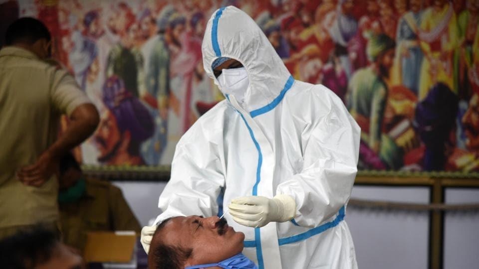 Medic collect nasal sample for Rapid Antigen Test.
