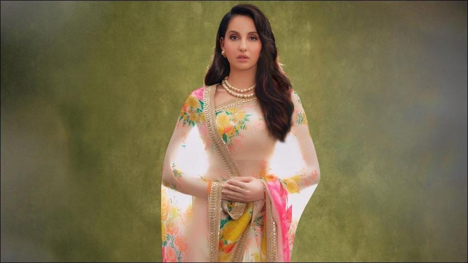 Nora Fatehi looks regal as she adds a dash of colours to our Sunday in a floral Sabyasachi saree