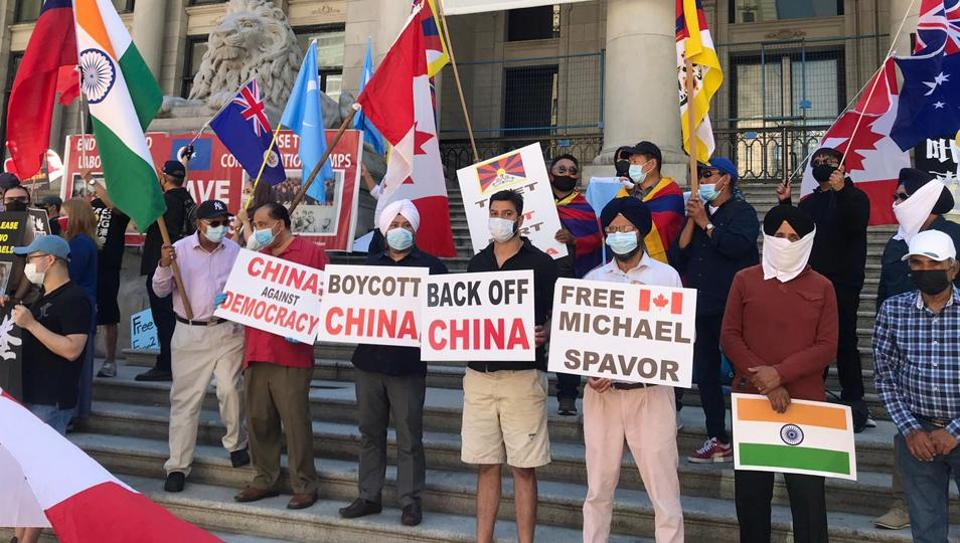 A protest against China outside the Chinese Consulate in Vancouver in July. Relations between Ottawa and Beijing have nosedived since the arrest of a senior executive of the Chinese telecommunications firm Huawei in 2018. In retaliation, China arrested two Canadians.