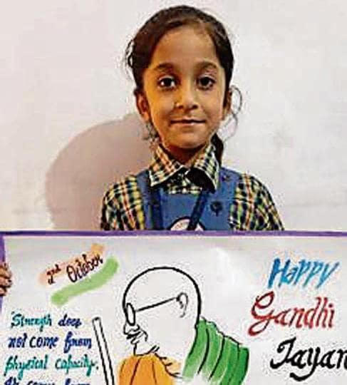 A student of GMA City Public School, Chabbewal,in Hoshiarpur, displaying her poster.