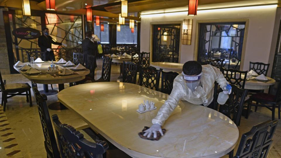 China Gate restaurant staff cleaning and sanitising the restaurant at Bandra ahead of its reopening on Monday.
