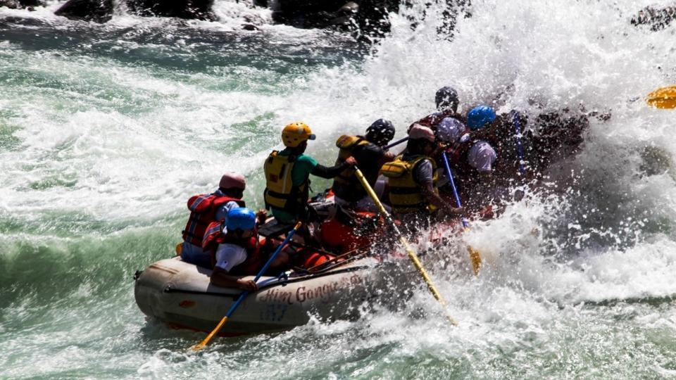 Tourists enjoying river rafting in Rishikesh