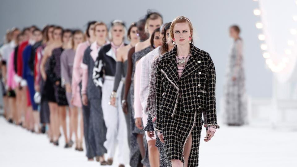Models present creations by designer Virginie Viard as part of her Spring/Summer 2021 ready-to-wear collection show for fashion house Chanel during Paris Fashion Week in Paris, France, October 6, 2020. (REUTERS)