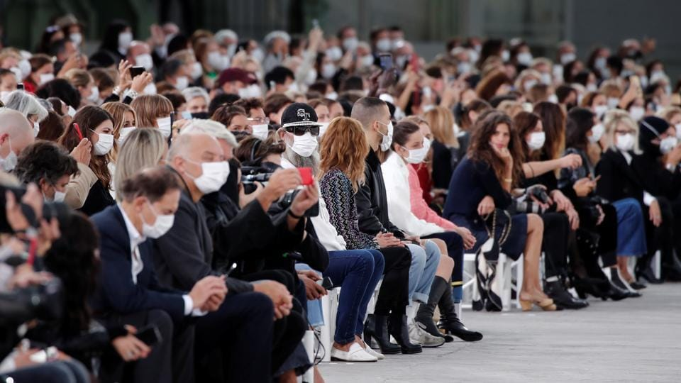 Guests wearing protective face mask attend the Spring/Summer 2021 ready-to-wear collection show by designer Virginie Viard for fashion house Chanel during Paris Fashion Week in Paris, France.  (REUTERS)