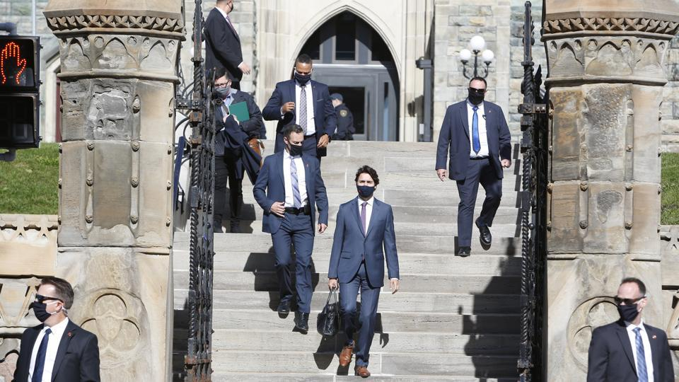 Justin Trudeau, Canada's prime minister (centre) walks to attend a news conference in Ottawa, Ontario, Canada, on October 1.
