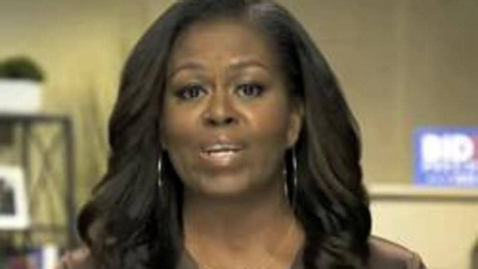 In the video, released Tuesday by Joe Biden's campaign, Mrs. Obama notes that more Americans have died from Covid-19 than died in the Iraq, Afghanistan, Vietnam and Korean wars combined.