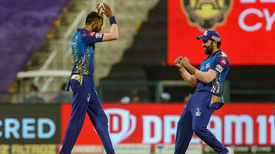 Mumbai Indians players Krunal Pandy and Rohit Sharma celebrate the wicket of Kings XI Punjab batsman Karun Nair during the Indian Premier League 2020 cricket match.