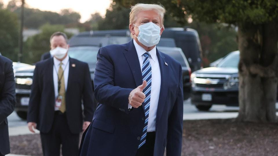 US President Donald Trump gives a thumbs up as he departs Walter Reed National Military Medical Center after a fourth day of treatment for the coronavirus disease (Covid-19).