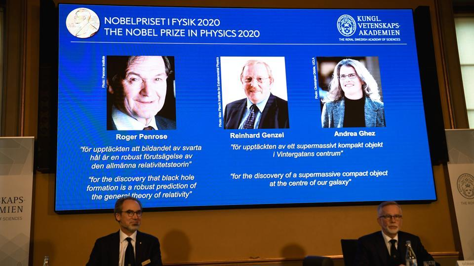 David Haviland, member of the Nobel Committee for Physics and Secretary General of the Royal Swedish Academy of Sciences Goran K. Hansson announce the winners of the 2020 Nobel Prize in Physics presented on the screen: Roger Penrose, Reinhard Genzel and Andrea Ghez during a news conference at the Royal Swedish Academy of Sciences, in Stockholm, Sweden October 6, 2020.