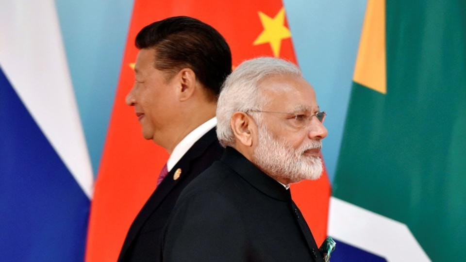 Chinese President Xi Jinping and Indian Prime Minister Narendra Modi attend the group photo session during the BRICS Summit at the Xiamen International Conference and Exhibition Center in Xiamen, southeastern China's Fujian Province, China September 4, 2017. REUTERS/Kenzaburo Fukuhara/Pool