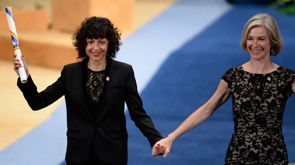 This file photo taken on October 23, 2015 shows French researcher in Microbiology, Genetics and Biochemistry Emmanuelle Charpentier (L) and US professor of Chemistry and of Molecular and Cell Biology, Jennifer Doudna on the stage after receiving the 2015 Princess of Asturias Award for Technical and Scientific Reseach from Spain's King Felipe during the Princess of Asturias awards ceremony at the Campoamor Theatre in Oviedo.