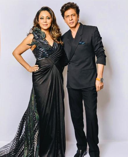 Gauri poses with Shah Rukh in a futuristic black structured saree gown by Amit Aggarwal.  (Instagram)