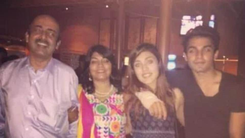 Rhea Chakraborty with her parents and brother.