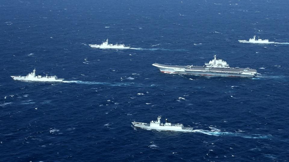 This aerial file photo taken on January 2, 2017 shows a Chinese Navy formation, including the aircraft carrier Liaoning (C), during military drills in the South China Sea.