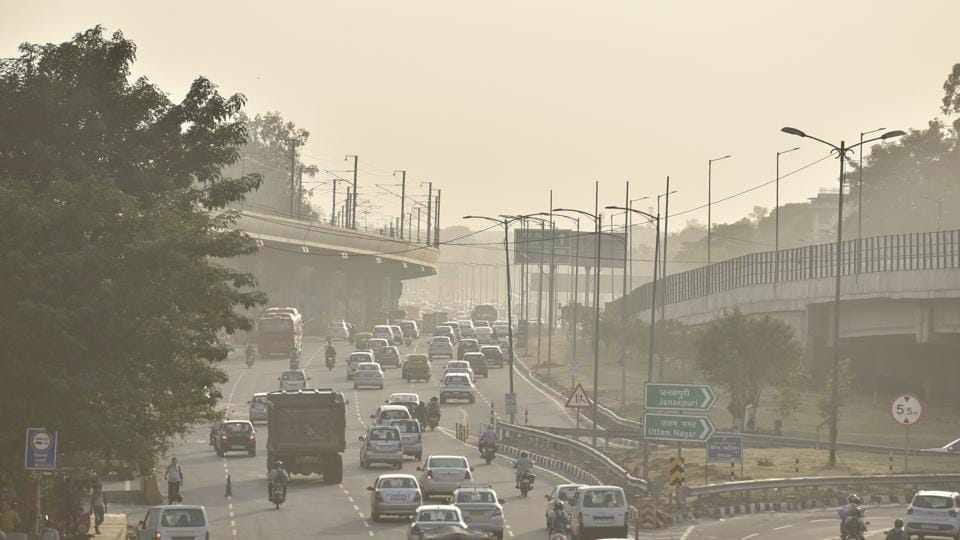 A rise in air pollution level due to undergoing construction work, at Dhaula Kuan, in New Delhi.