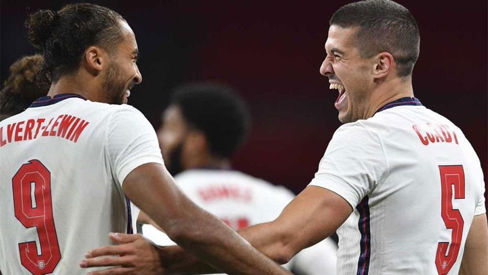 England defender Conor Coady (R) celebrates with Dominic Calvert-Lewin.